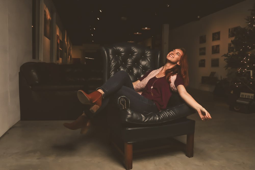 woman sitting in a leather sofa