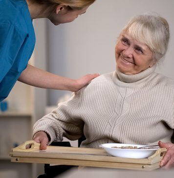 Old woman inquiring about aged care financial planning to a medical worker
