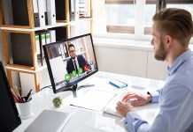 Businessman trying out video conferencing solutions in Melbourne