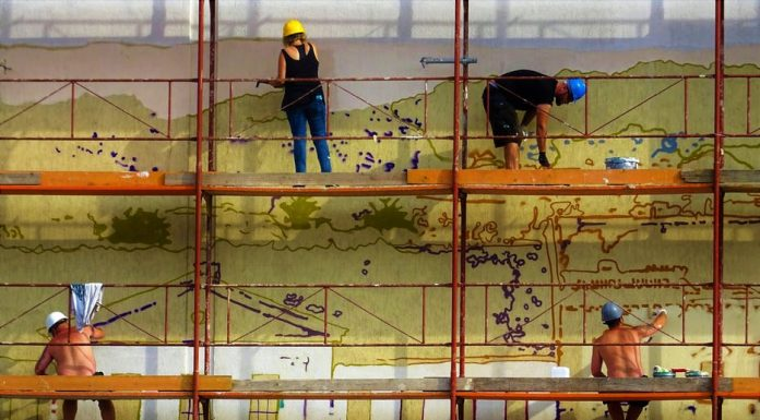 Painters using a scaffold while working