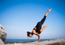 Professional online yoga teacher doing a pose