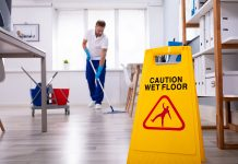Male janitor offering commercial office cleaning services