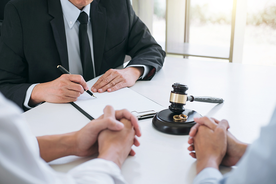 Family lawyer in Sydney talking to a couple finalizing their divorce