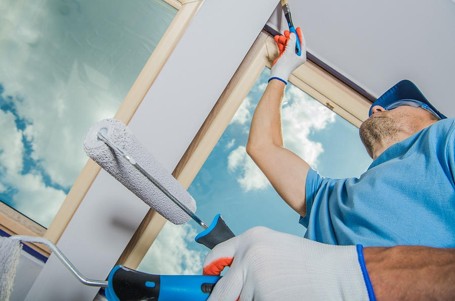 Commercial painting companies Melbourne workers doing some wall finishing