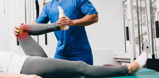 Chiropractor in Baulkham Hills treating a patient's knee