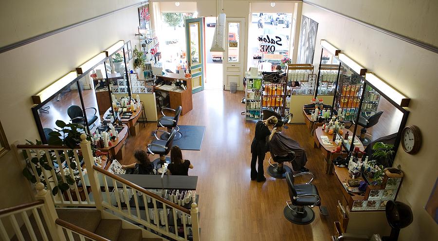 Stylist accommodating a client inside a hair salon