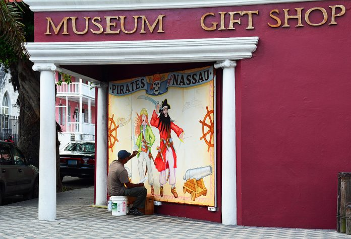 Great mural artist in Sydney painting the museum exterior