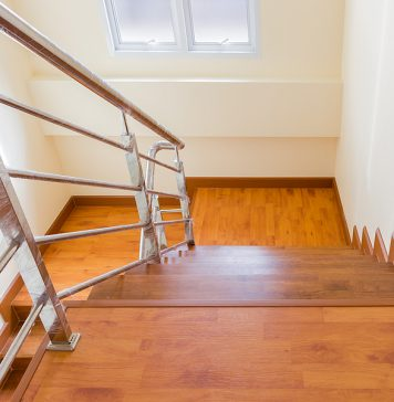 Stainless steel wire balustrade installed in a wood staircase